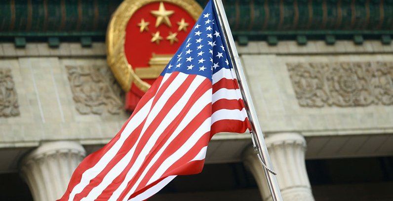 Thomas Peter-Pool/Getty Images: US flag in Beijing, China