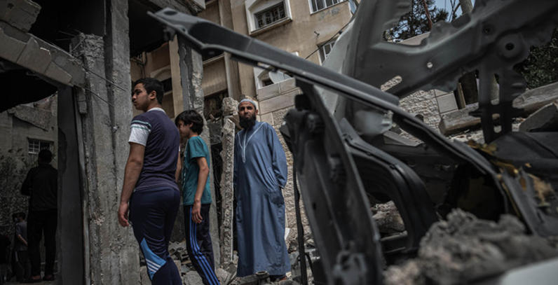 Residents inspect damage following recent airstrikes in Gaza.