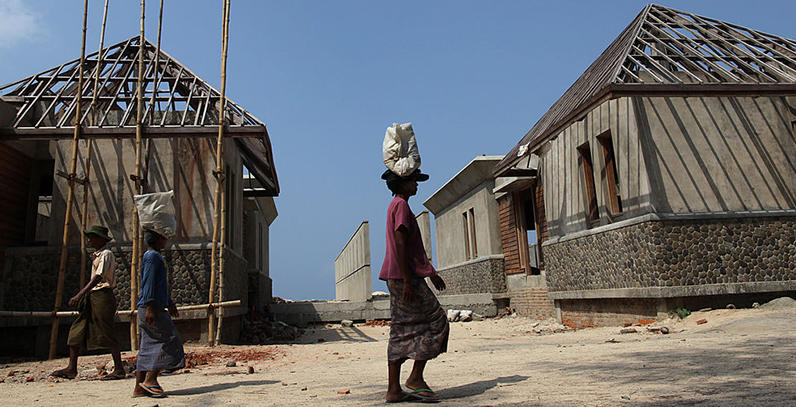 Burmese workers carry cement at a construction site along the Bay of Bengal.