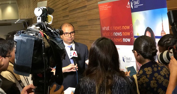 Press interviewing official at the 2018 EWC International Media Conference in Singapore
