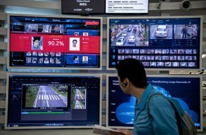 Monitors at Huawei's Bentian campus in Shenzhen, China, display AI applications for facial recognition. Photo: Kevin Freyer/Getty Images.