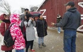Chinese journalists visit a soyban farm in Iowa