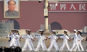 adets from China's People's Liberation Army (PLA) Navy march in formation before a ceremony to mark Martyr's Day at Tiananmen Square in Beijing