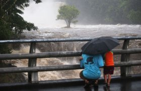 Bystanders watch river flooding during Hurricane Lane in Hawaii