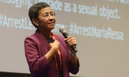 Maria Ressa speaking at an EWC International Media Conference