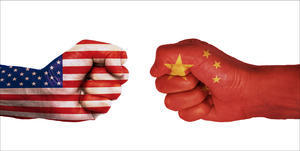 Graphic of opposing fists with US and China flags