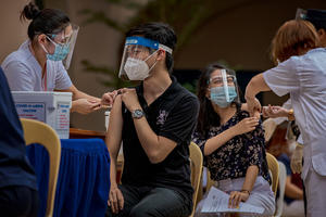 Health workers take part in a mock COVID-19 vaccination drill in the Philippines.