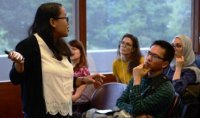 A woman responds to questions at the International Graduate Student Conference.