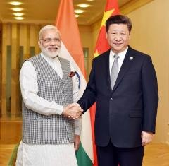 Indian Prime Minister Modi and Chinese President Xi's relationship has grown in recent years, presenting a delicate balancing act for the United States. Image: Flickr user Narendra Modi.