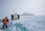 MOSAiC expedition researchers move instruments over sea ice. Photo: Alfred-Wegener-Institut/Lianna Nixon (CC-BY 4.0)