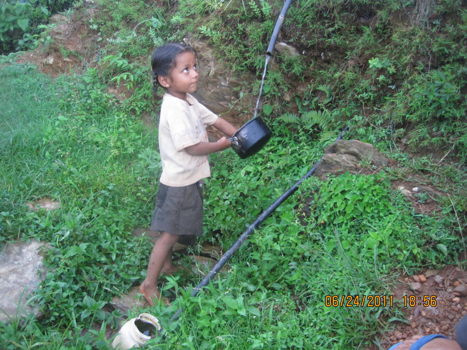 Photo of little girl collecting water in the mid-hill region in Nepal