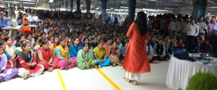 Experiential Professional Development (XPD) Fellow training over 1,000 factory workers on health and sanitation
