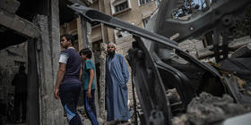 Residents inspect damage following recent airstrikes in Gaza. Photo: Fatima Shbair / Getty Images