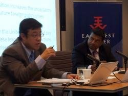 (Click to enlarge) Visiting fellow Kai He addresses the audience in off-the-record program as director of the East-West Center in Washington, Dr. Satu Limaye, looks on.
